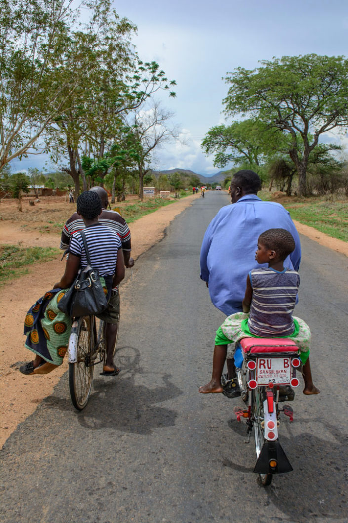 Bicycle taxis race each other in Malawi