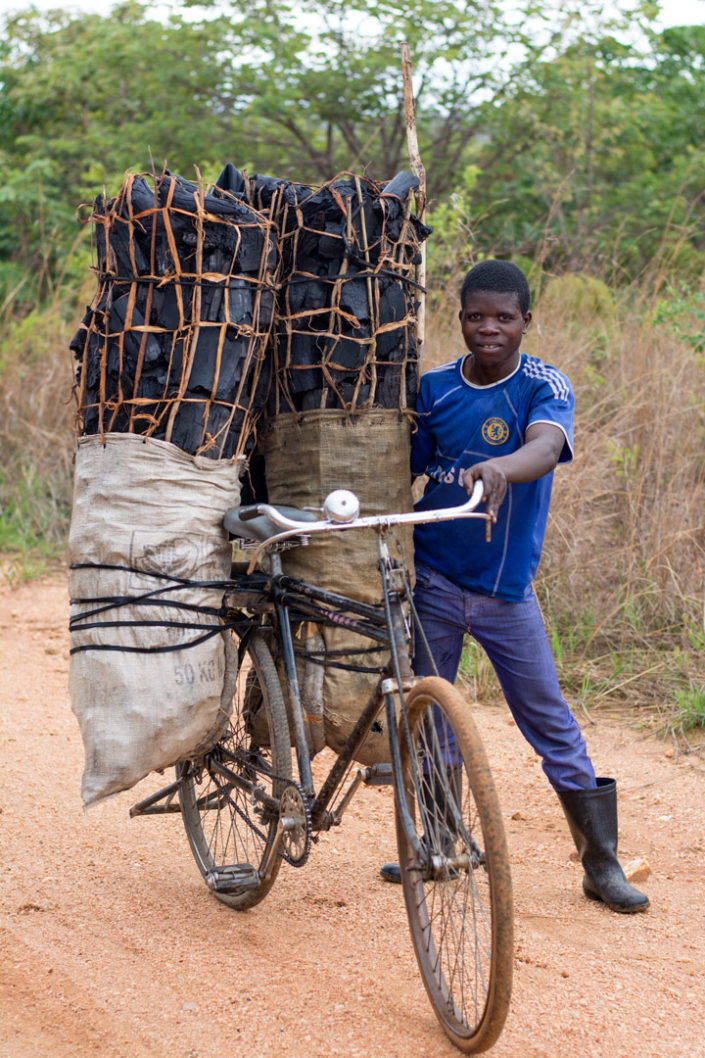 An African cycling charcoal carrier.