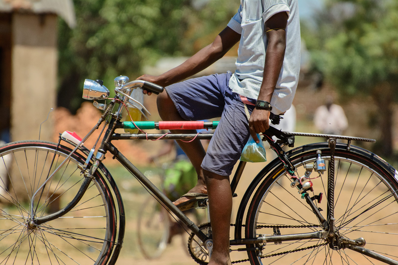 An African cyclist heads home.