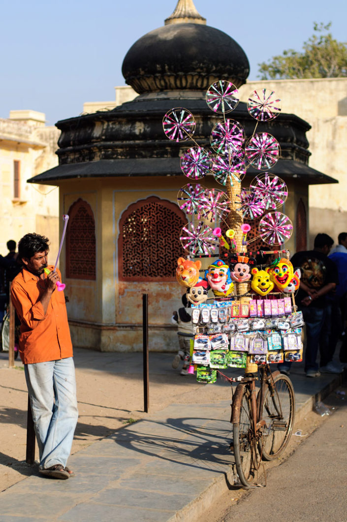 A bicycle is loaded up with toys for sale in India