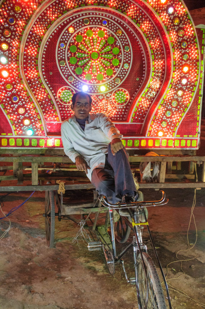 A neon wedding rickshaw in India