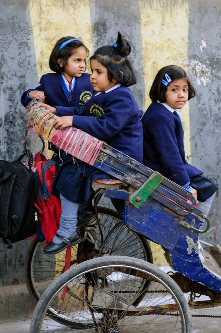 A rickshaw full of schoolgirls in India