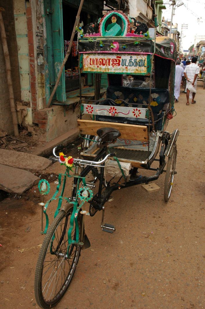 A highly decorated bicycle rickshaw in South India