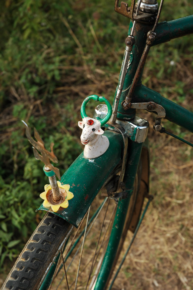 A bicycle fender is decorated with a Hindu god in India