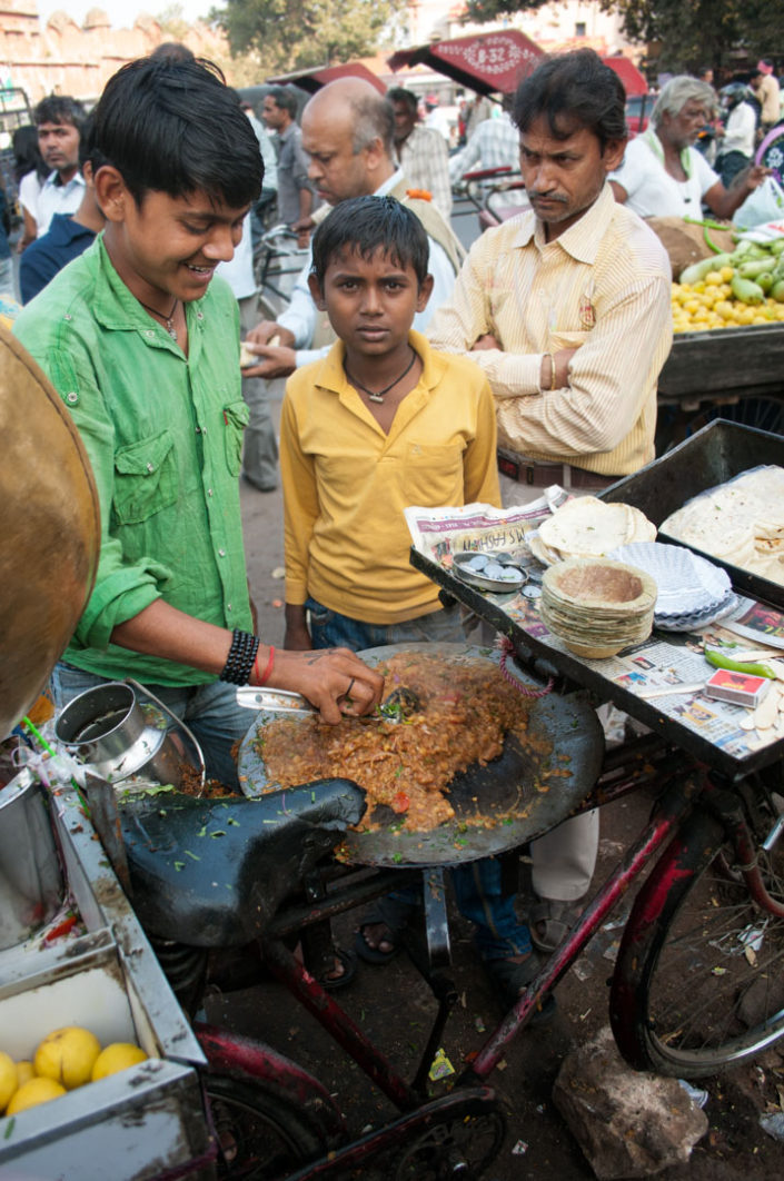 Cooking on top of a bicycle in India