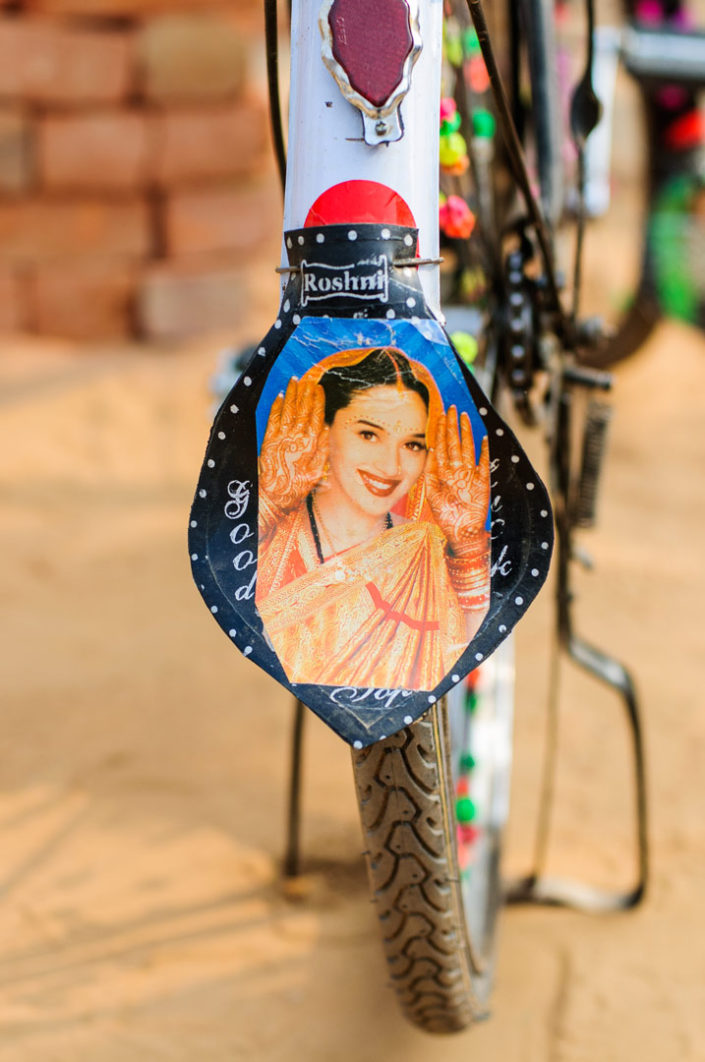 A decorated bicycle fender mud flap in India