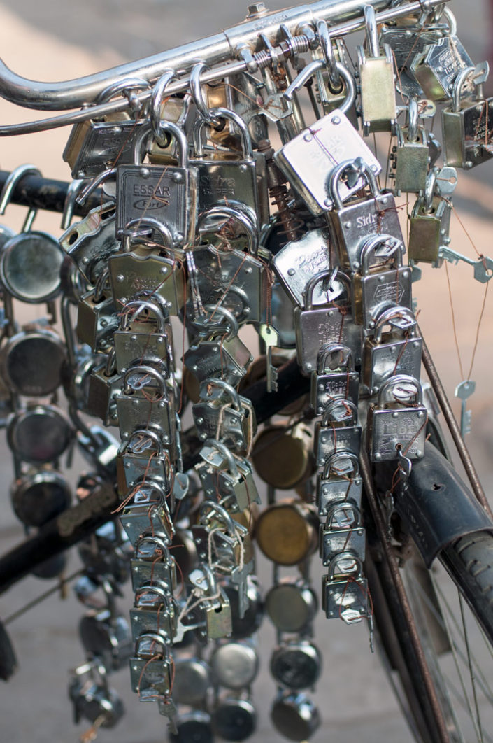 Locks hang over the handlebars of a bicycle in India
