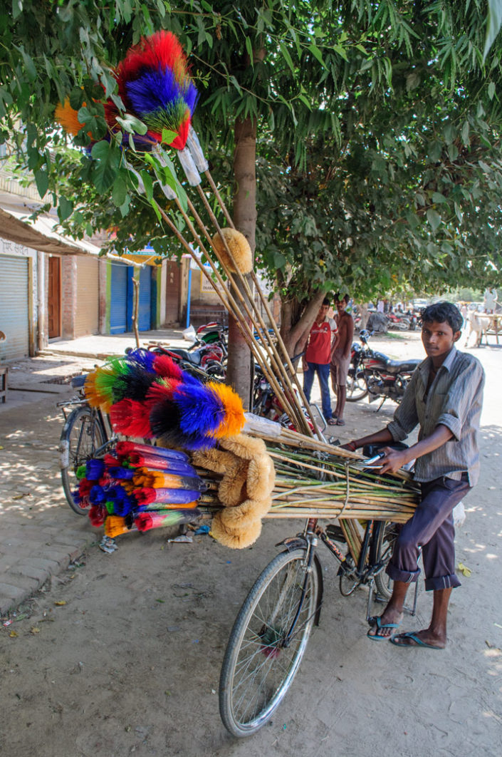 A bicycle is loaded up with brooms for sale in India.