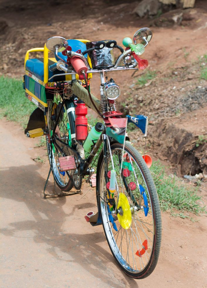 An exaborately decorated bicycle taxi in Malawi