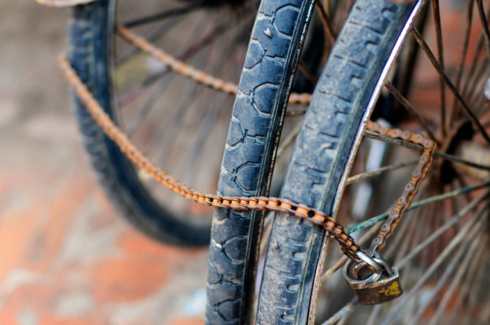 Bicycle wheels are chained up in Nepal