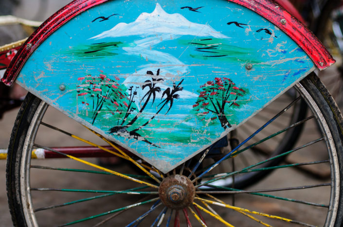 A mountain is painted on a rickshaw in Nepal