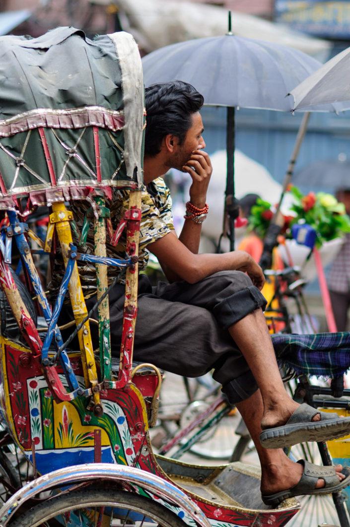 A rickshaw chauffeur waits for customers in Nepal