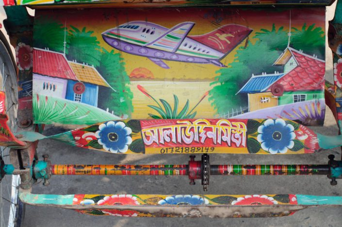 An airplane is painted on a rickshaw in Bangladesh