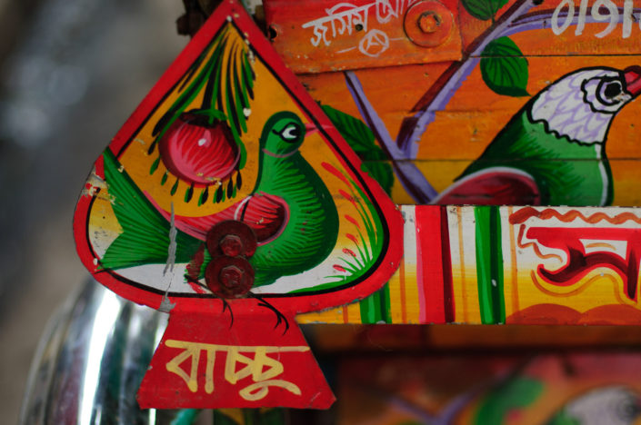 Painted birds decorate a rickshaw in Bangladesh