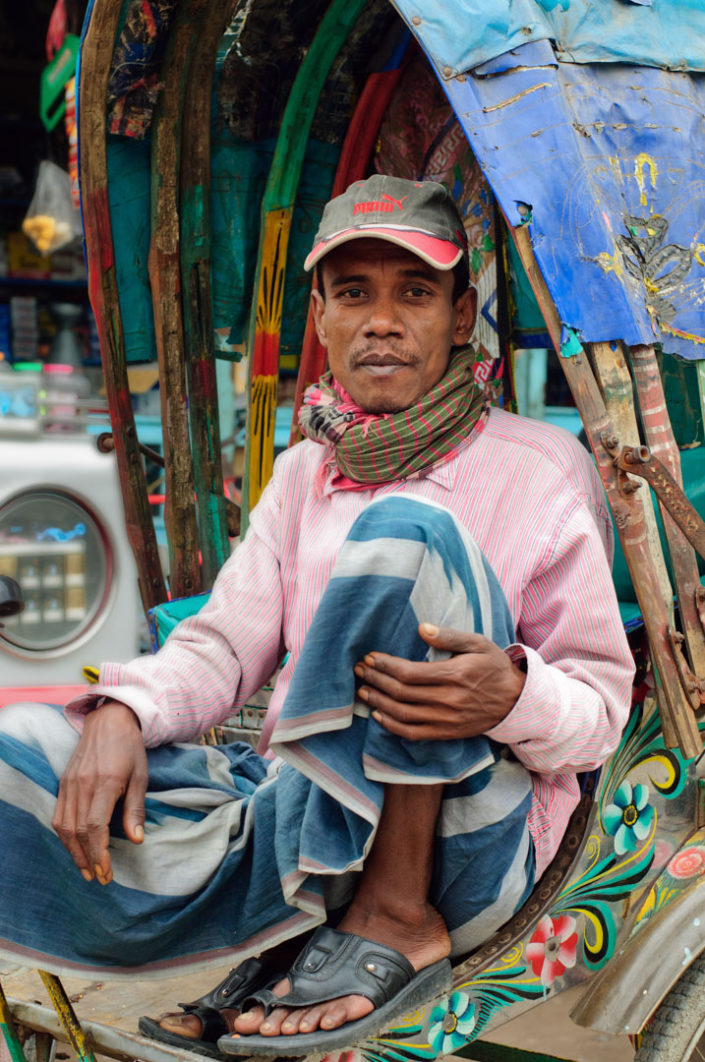 A Bangladesh chauffeur poses for the camera.