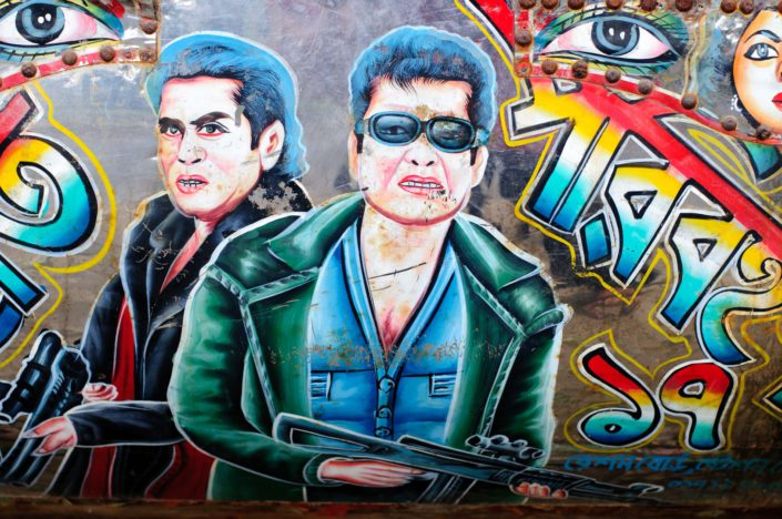 Paintings of film villains decorate a Bangladesh rickshaw