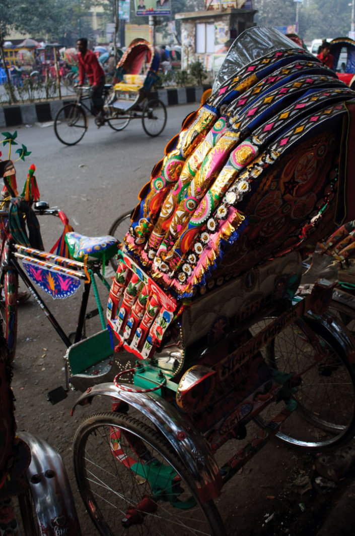 A brightly decorated rickshaw in Dhaka , Bangladesh.
