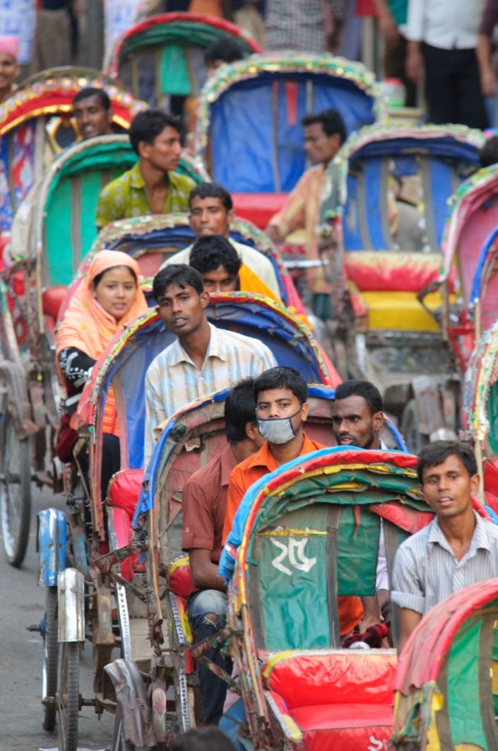 Dhaka cycle rickshaws sit in a traffic jam