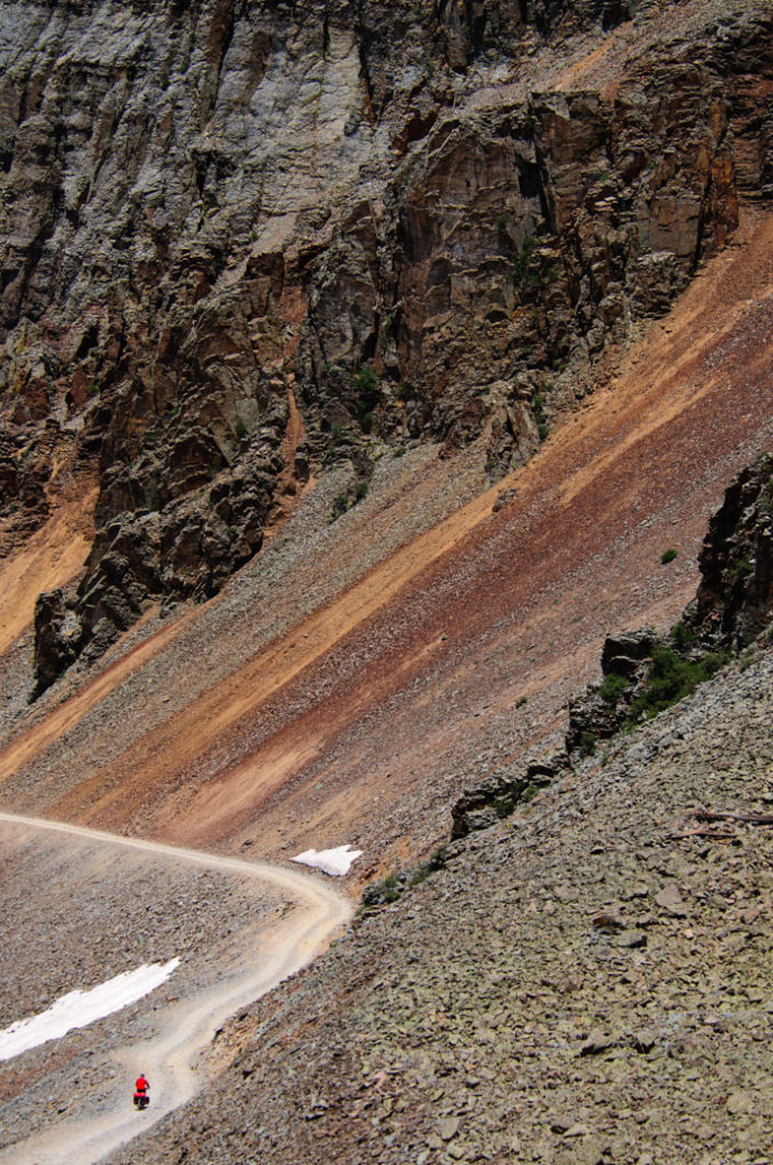 A cyclist heads down Ophir pass