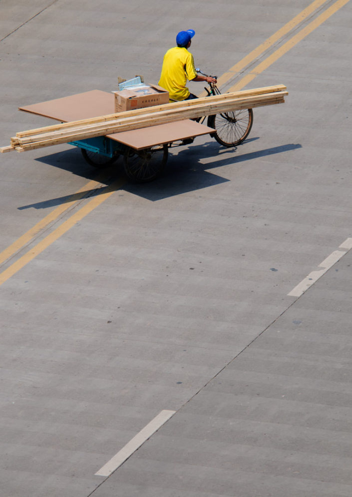A cargo bike transports plywood