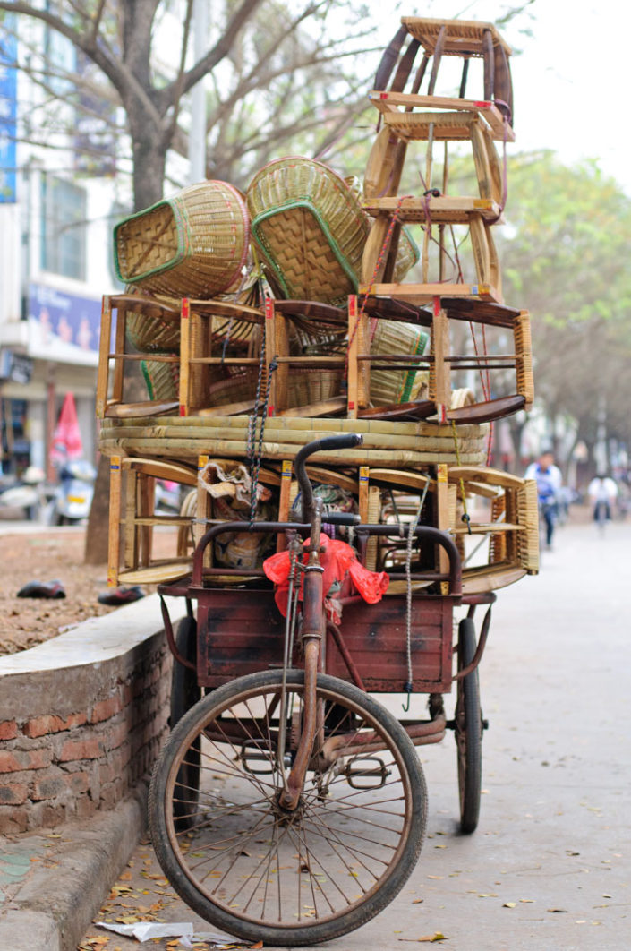 A cargo bike full of rotan furniture in China