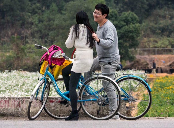 Chinese tourists riding their bicycles