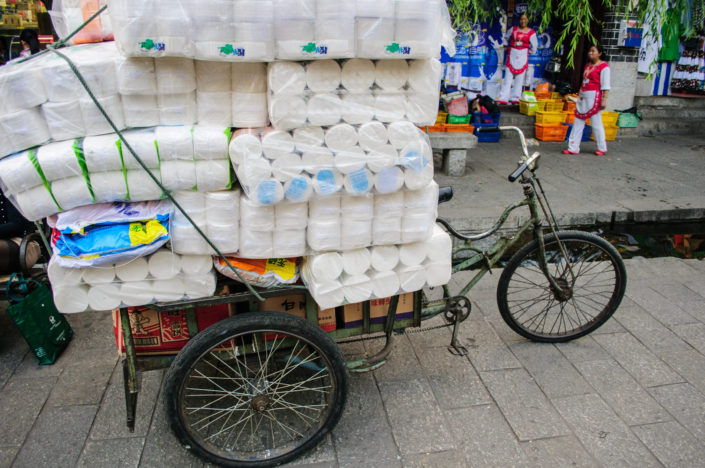 A cargo bike in Dali, China is loaded up with toilet paper.