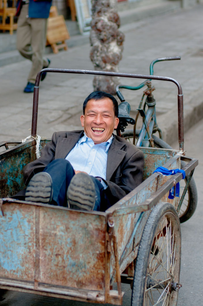 A Chinese man wakes up from a nap in his cargo bike in China