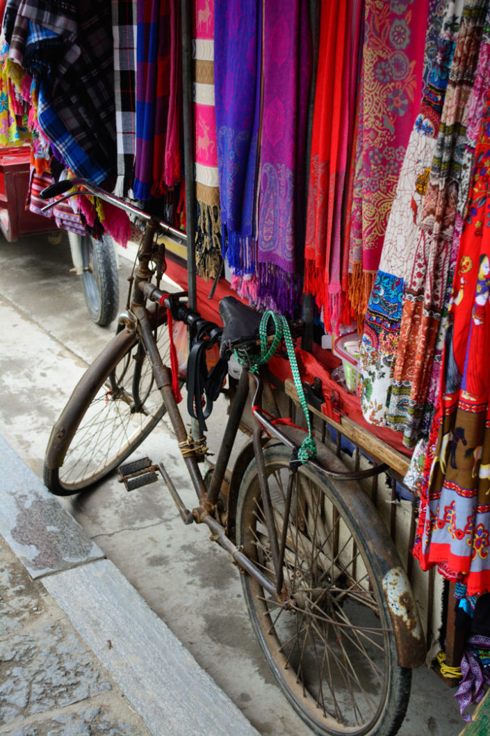 A bicycle holds a rack full of clothes in China