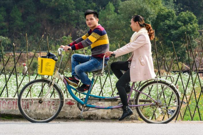 Cycling Chinese tourists in Yangshuo China
