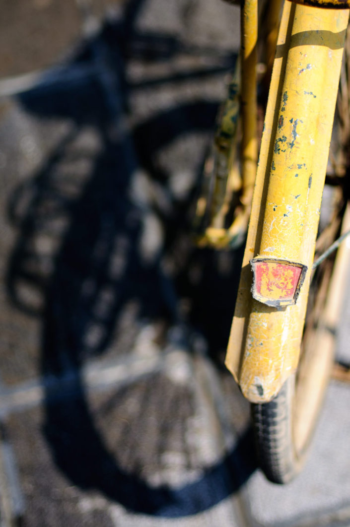 A yellow bicycle fender