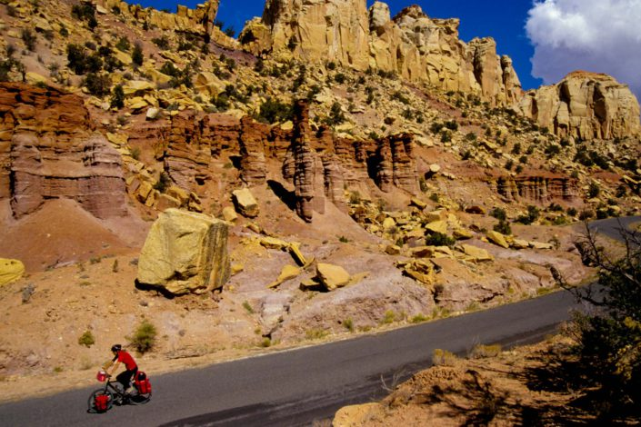 A cyclist heads down the Burr Trail road