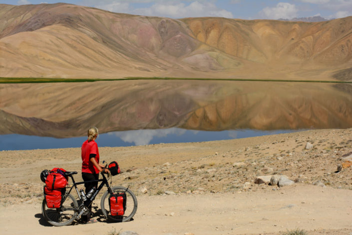 A cyclist looks over Bulun Kul in Tajikistan.