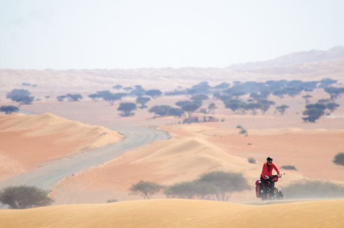 Bicycle touring through the desert in Oman.