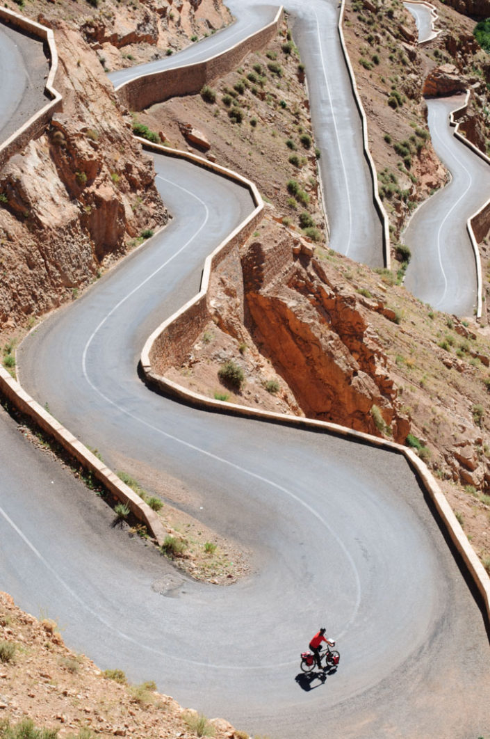 Cycling down switchbacks in Southern Morocco