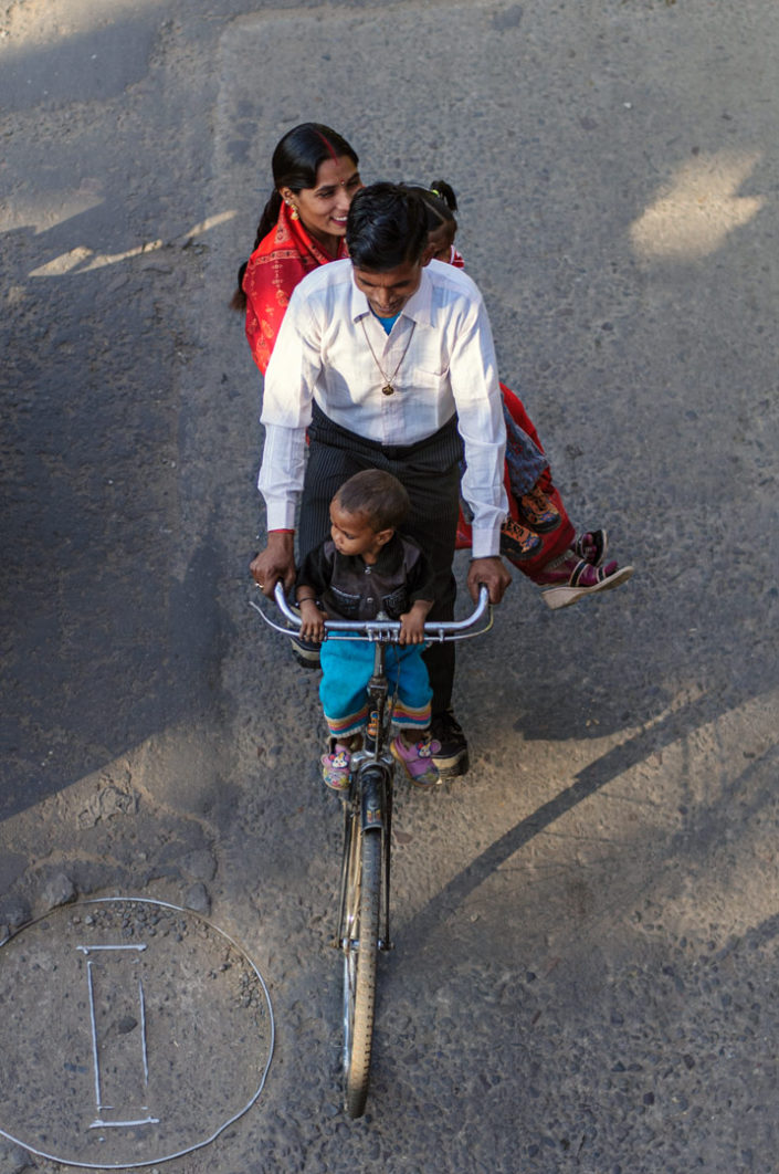 A family rides a bicycle in India.