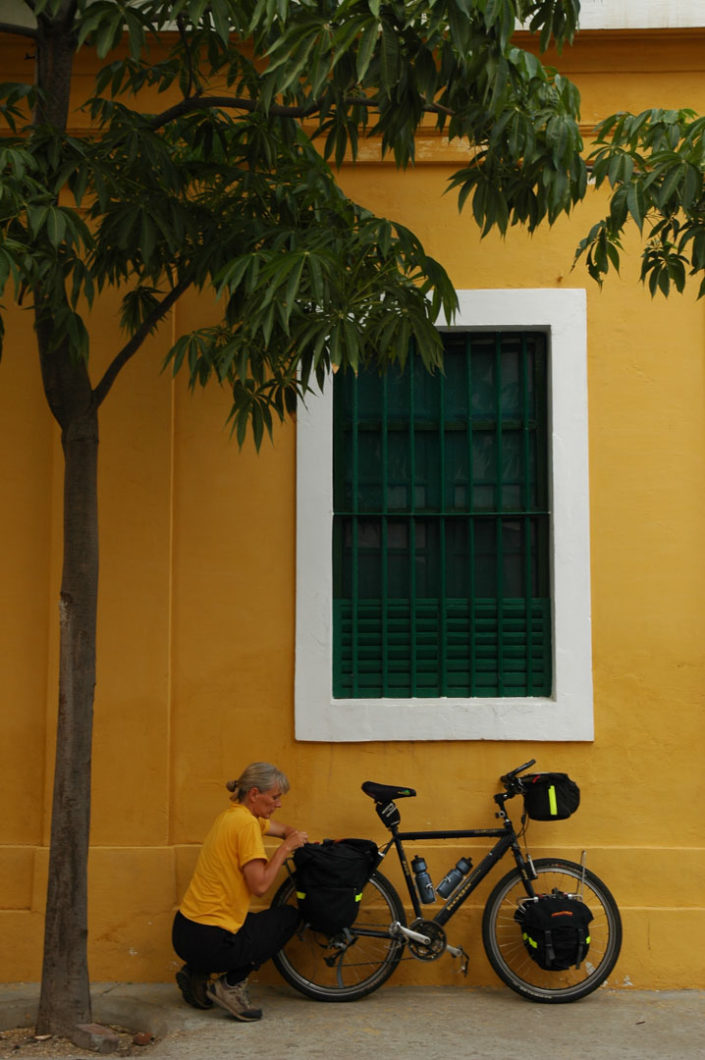A cyclist loads their panniers in Pondicherry, India