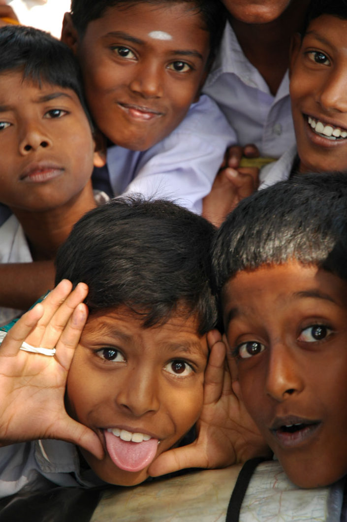 Kids pull faces in India.