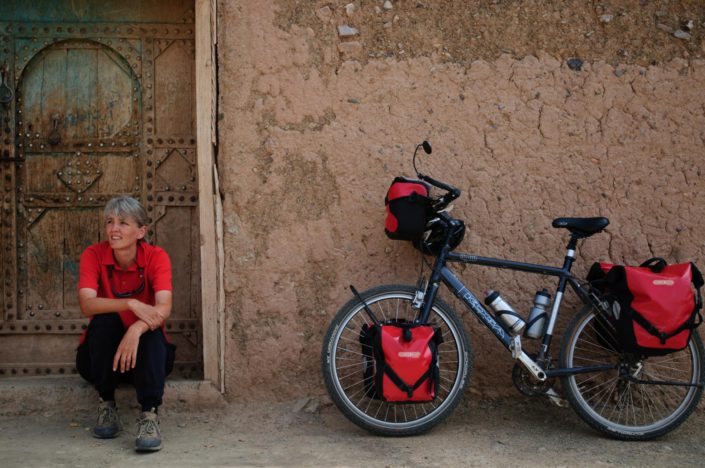 A touring bicycle is leaned against a wall in Morocco