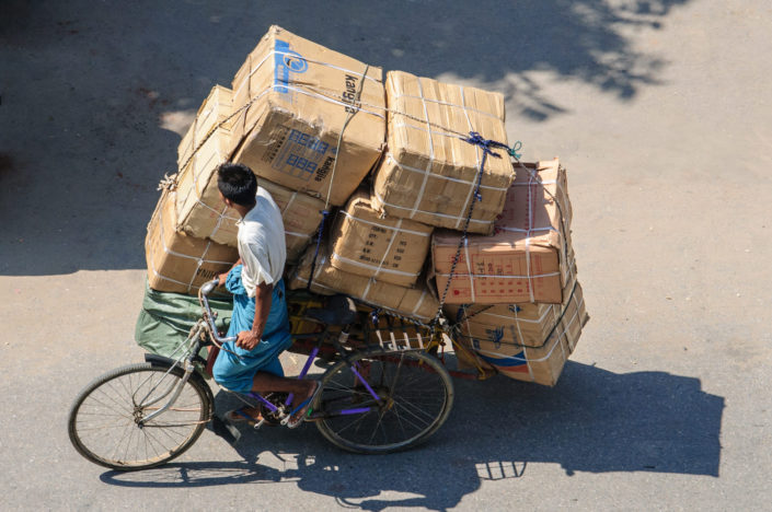 An overloaded trishaw in Myanmar