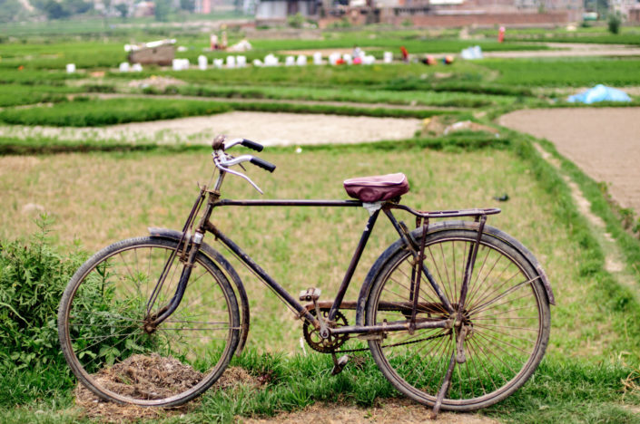 An old Nepal bicycle stands near a field in Nepal