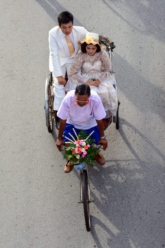 Rickshaws ferry passengers in fancy dress during a parade in Thailand
