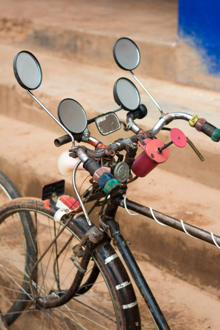 A bicycle in East Africa is decorated with multiple mirrors.
