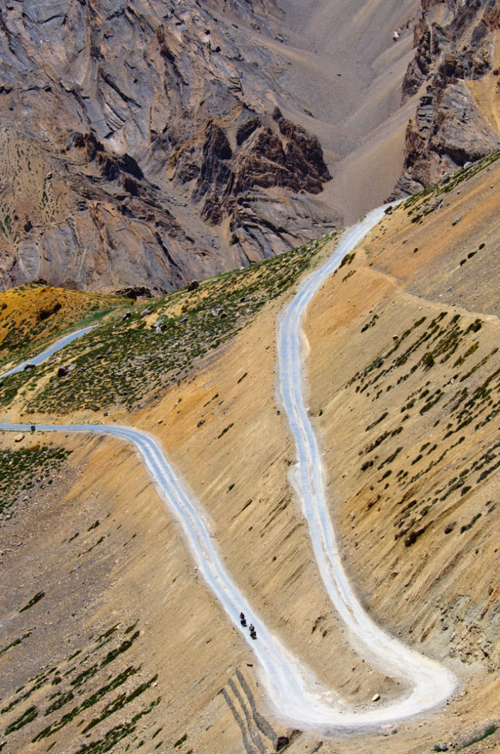 2 cyclists head down the Gata loops on the Leh- Manali highway.
