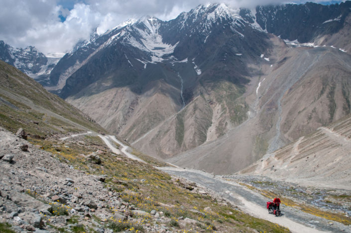 A cyclist takes a pause while heading up the Kunzum La pass in North India.