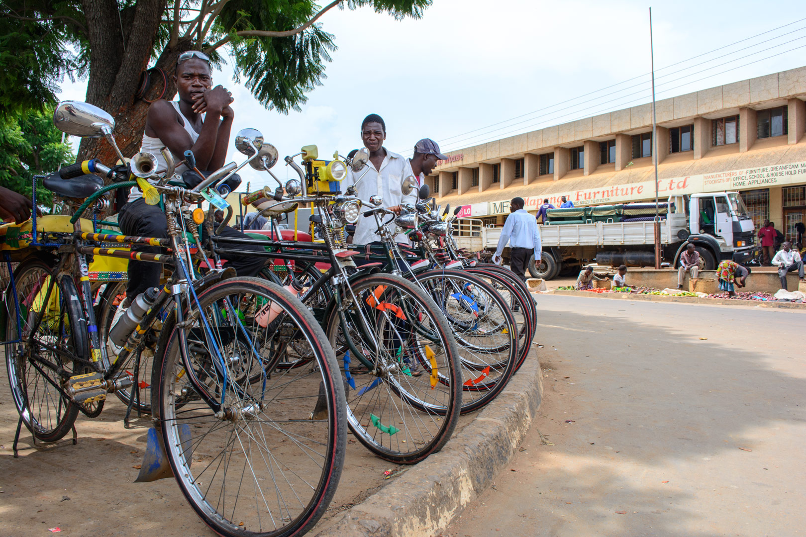 African bicycle chauffeurs wait for customers