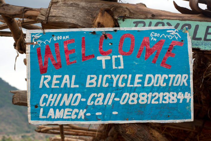 A sign advertising a real bicycle doctor in Africa