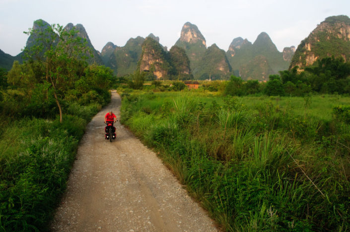 Cycling through the Karst mountains near Yangshuo, China