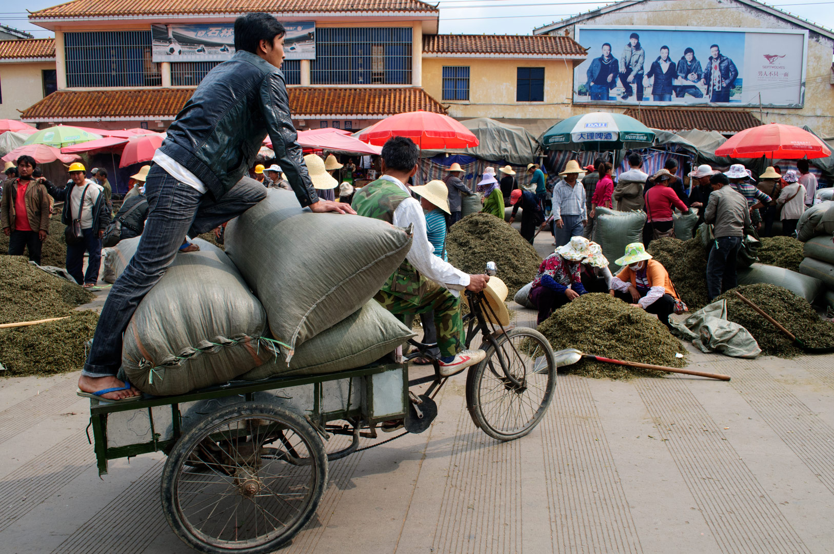 A cargobike transports goods to the market in China