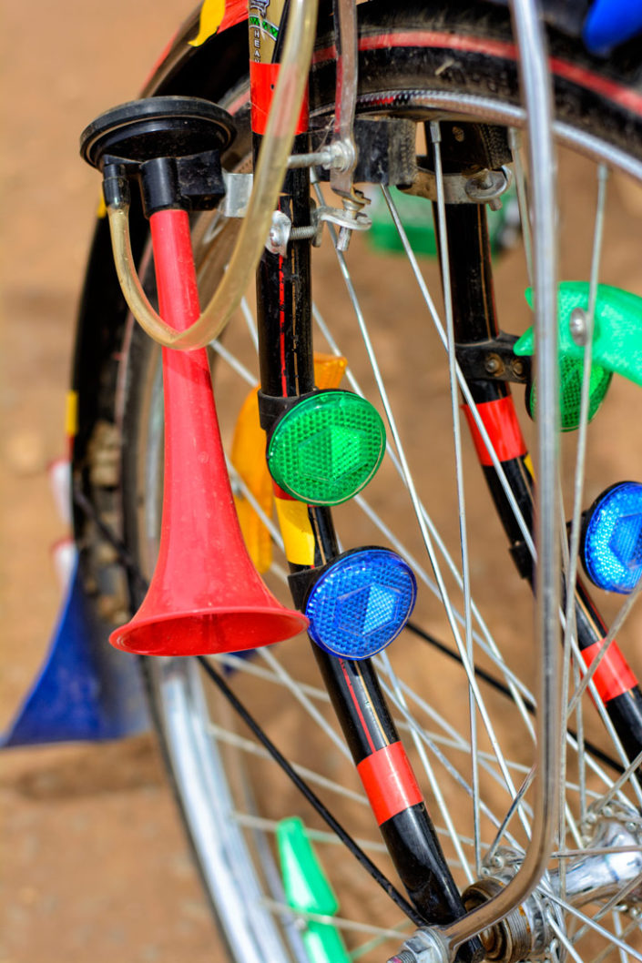 A bicycle front wheel full of reflectors plus a horn in Africa